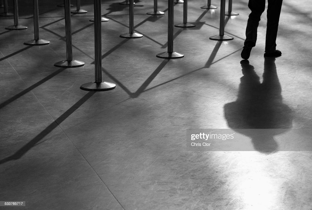 Shadow of man and roped-off barriers : Foto stock