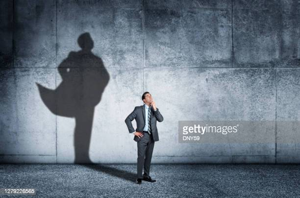 shadow of man aspiring to confidence - cape stock pictures, royalty-free photos & images