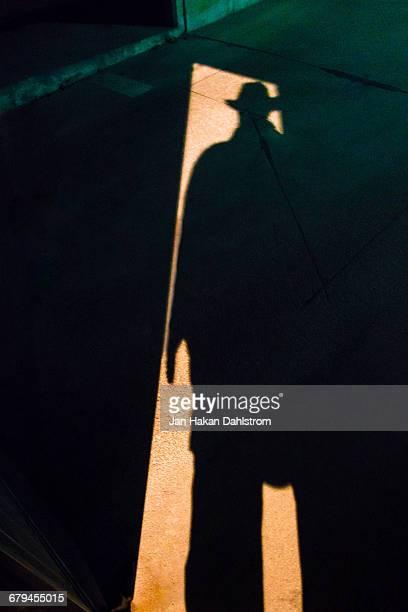 Shadow of man in hat in doorway