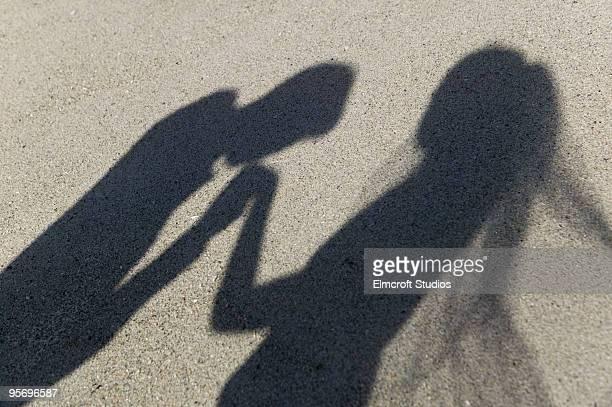 shadow of man kissing woman's hand - velo fotografías e imágenes de stock