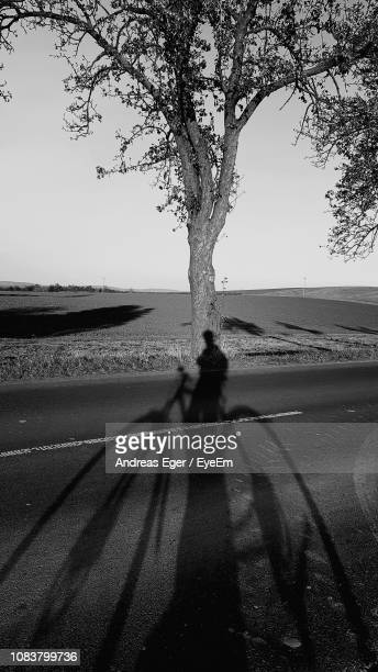 Shadow Of Man On Bicycle Against Clear Sky