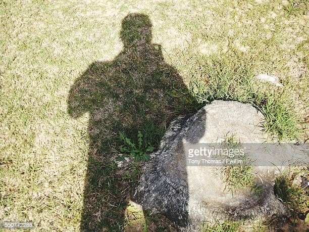 Shadow Of Man On Ground
