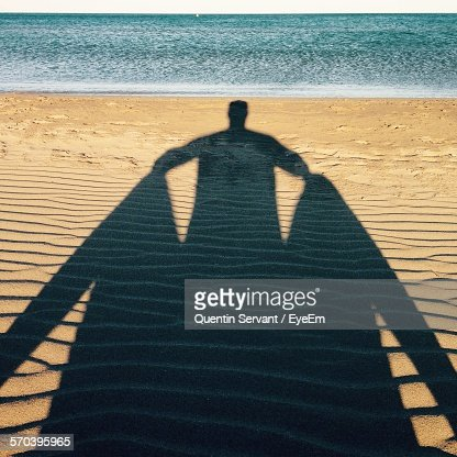 Shadow Of Man On Sand At Beach