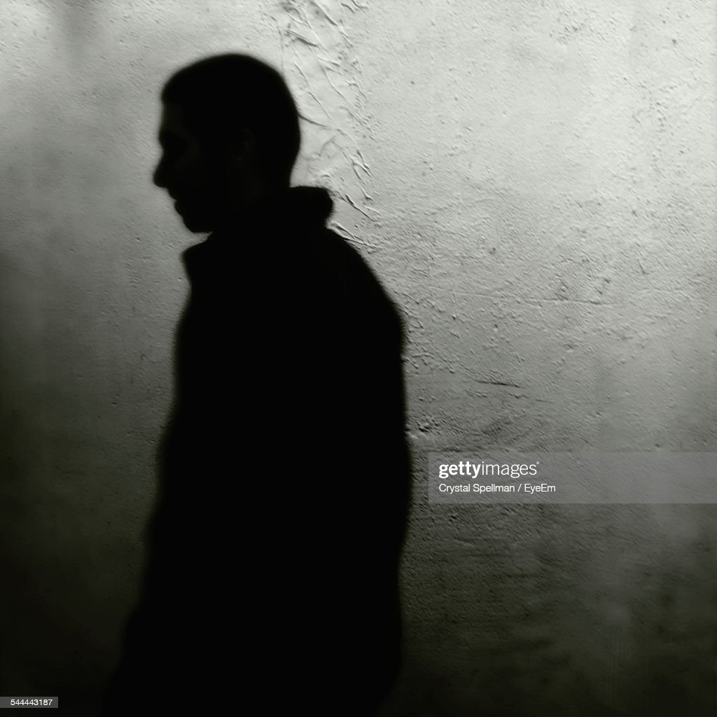 Shadow Of Man On Wall At Night : Stock Photo