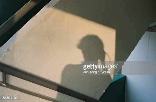 Shadow Of Man On Wall