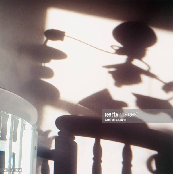 shadow of mobile over crib - mobile stockfoto's en -beelden