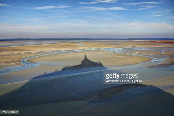 Shadow Of Mont Saint-Michel Against Cloudy Sky