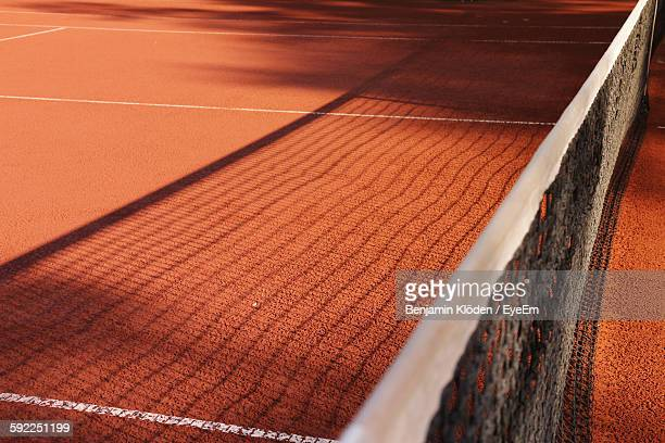 Shadow Of Net On Tennis Court
