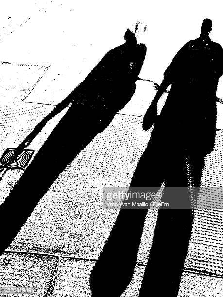 Shadow Of People Falling On Footpath