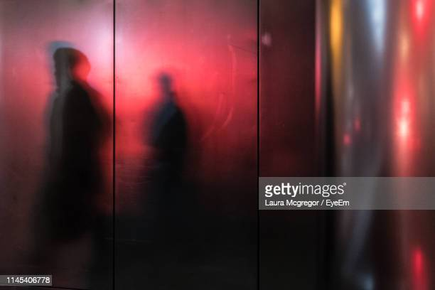 shadow of people on elevator - mcgregor stock pictures, royalty-free photos & images