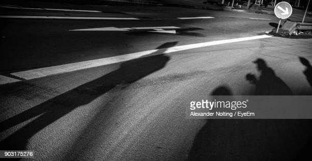 Shadow Of People On Road At Night