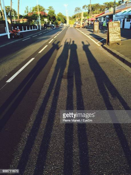 Shadow Of People On Road In City