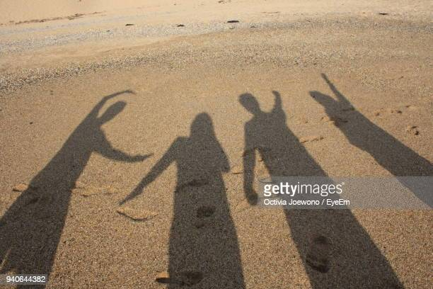 Shadow Of People On Sand At Beach