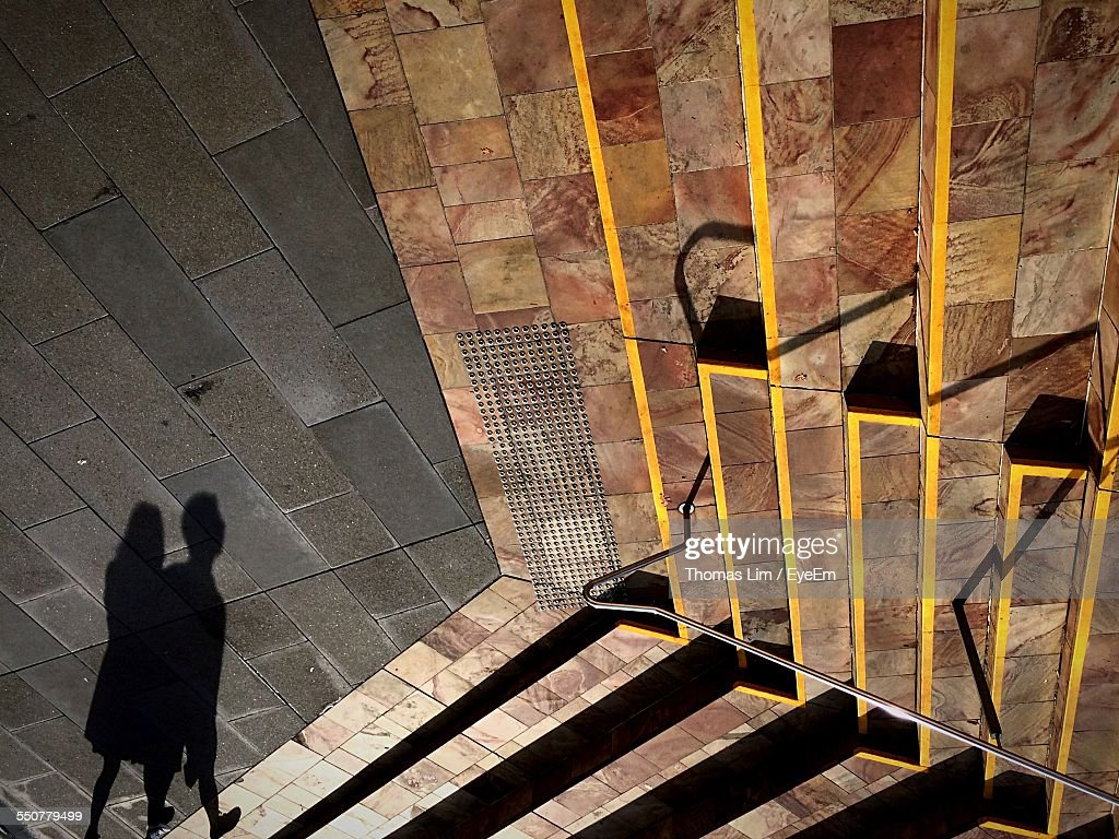 Shadow Of People Walking On Street By Steps : Stock Photo