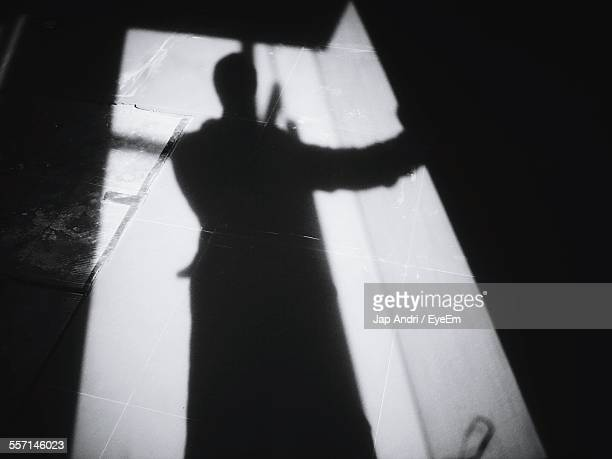 shadow of person in doorway - human representation stock pictures, royalty-free photos & images