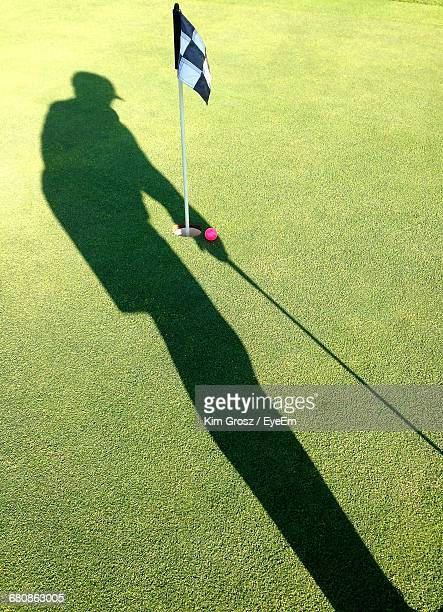 Shadow Of Person On Golf Court