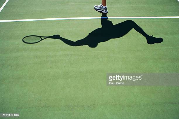 Shadow of person playing tennis