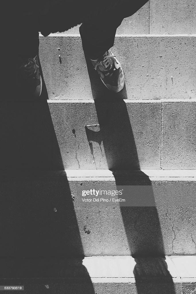 Shadow Of Person Standing On Stairs : Foto stock