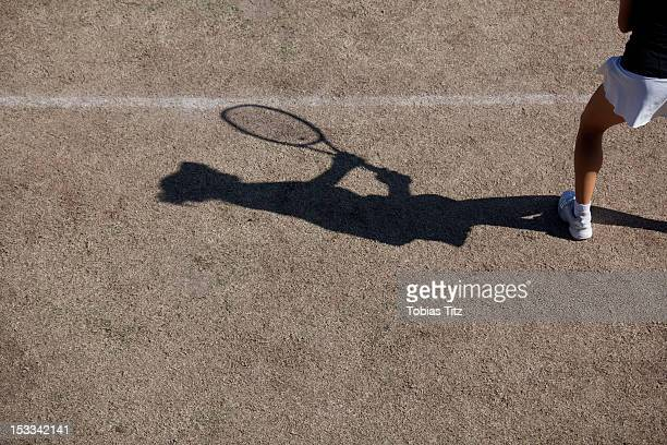 Shadow of tennis player