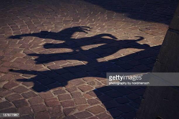 Shadow of town musicians on street, Bremen