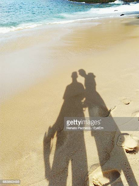 Shadow Of Two People On Beach