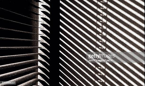 Shadow Of Window Blinds On Wall At Home