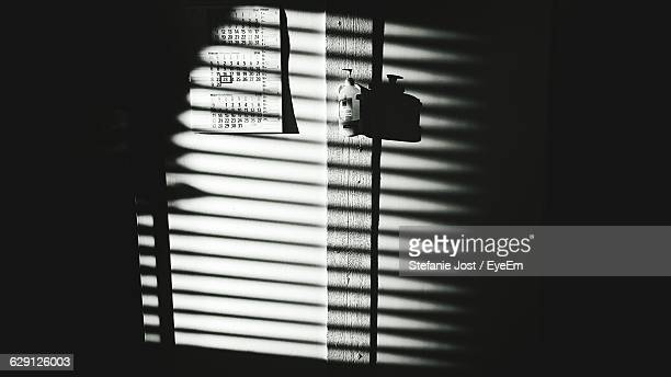 Shadow Of Window Blinds On Wall