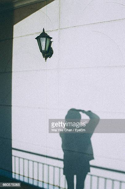 Shadow Of Woman Against Wall