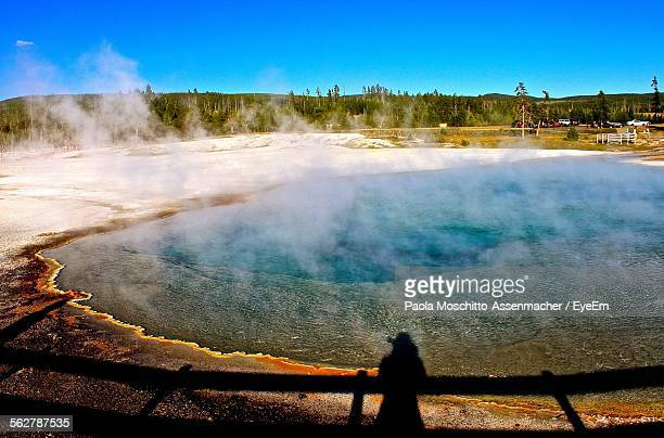 Shadow Of Woman And Railing Falling On Grand Prismatic Spring Against Blue Sky