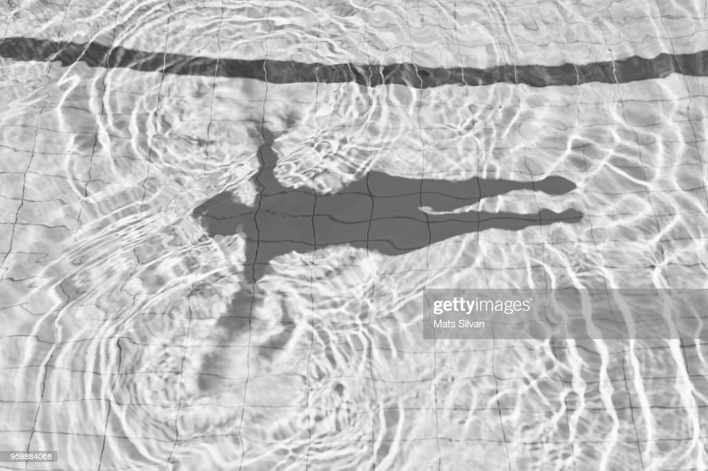 Shadow of Woman Floating on the Water : Stock-Foto