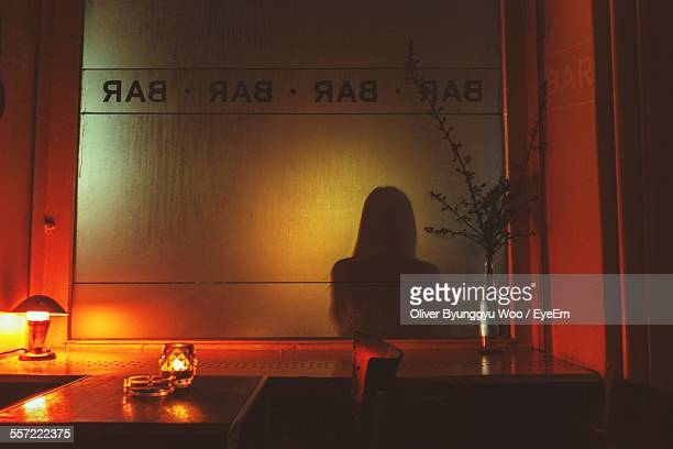Shadow Of Woman On Glass In Bar