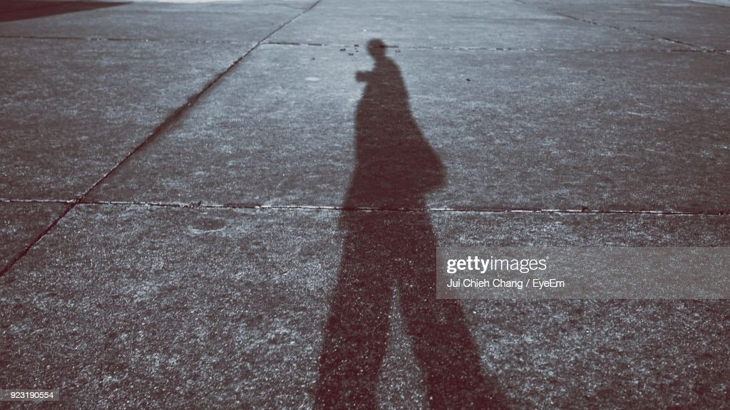 Shadow Of Woman On Road : Stock Photo