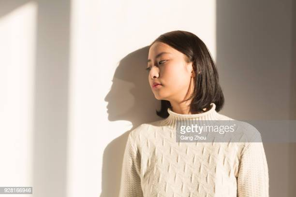 shadow of young woman,portrait - leaning stock pictures, royalty-free photos & images
