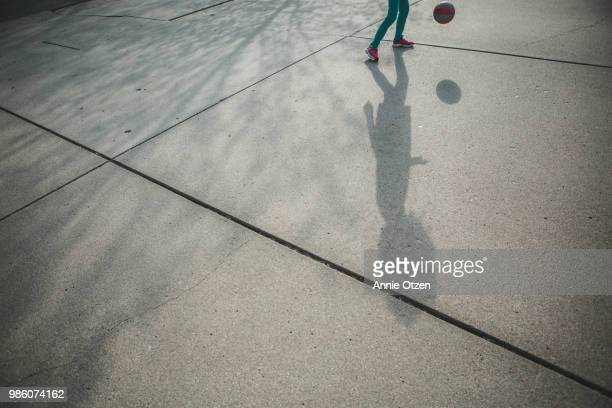 shadow playing basketball - drive ball sports stock pictures, royalty-free photos & images
