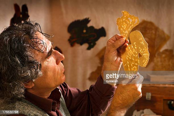 shadow puppet maker - shadow puppet stock photos and pictures
