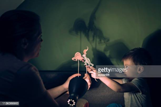 shadow puppet show - shadow puppet stock photos and pictures