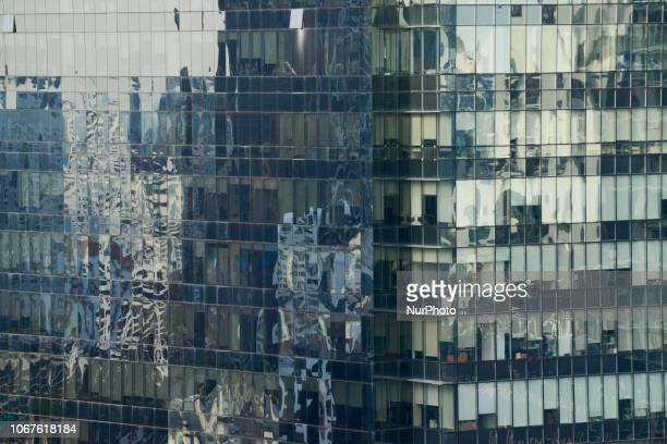Shadow reflected as window on an office building in Bangkok Thailand 02 December 2018