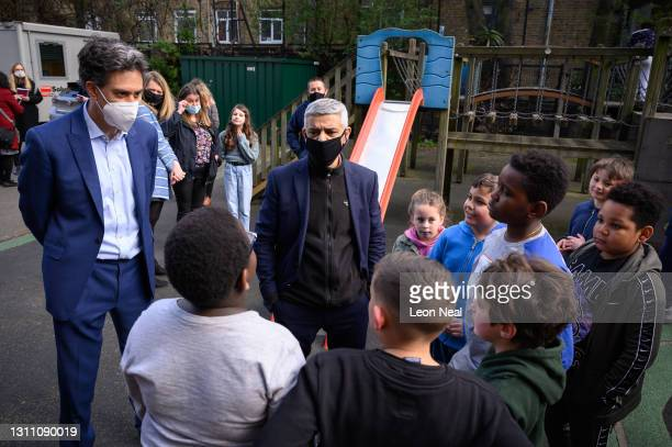 Shadow Secretary of State for Business, Energy and Industrial Strategy Ed Miliband and Mayor of London Sadiq Khan speak with children during a...
