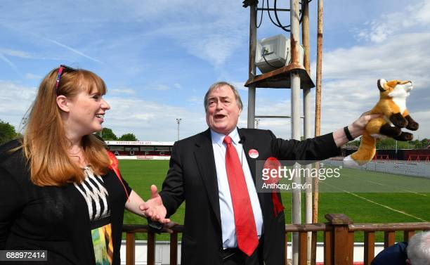 Shadow Secretary of State for Education Angela Rayner looks on as Lord John Prescott holds a stuffed fox during a stump speech at Ashton United...