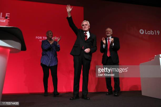 Shadow Shadow Chancellor John McDonnell is applauded by Labour Party Leader Jeremy Corbyn as he delivers his keynote speech on the third day of the...