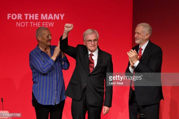 Shadow Shadow Chancellor John McDonnell is applauded by Labour Party Leader Jeremy Corbyn after delivering his keynote speech on the third day of the...