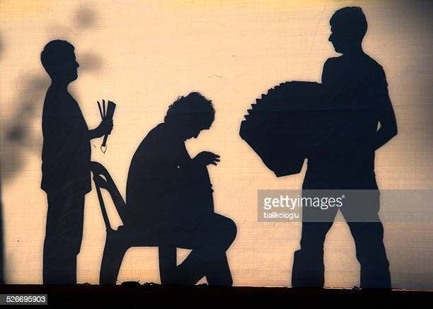 shadow theater - accordionist stock pictures, royalty-free photos & images