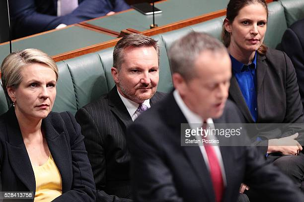 Shadow Treasurer Chris Bowen listens to Opposition leader Bill Shorten deliver his budget reply speech on May 5 2016 in Canberra Australia The...
