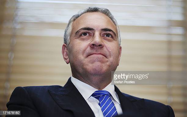 Shadow Treasurer Joe Hockey listens to Opposition Leader Tony Abbott speak to Coalition MPs in the party room on June 28 2013 in Canberra Australia...
