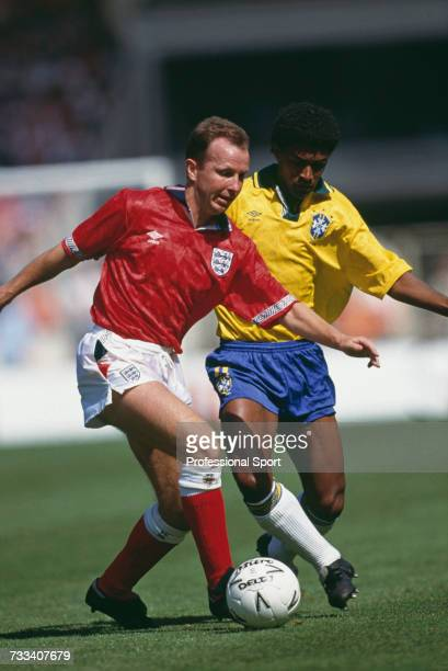 Shadowed by a Brazil player, England midfielder Trevor Steven makes a run with the ball in the international friendly match between England and...