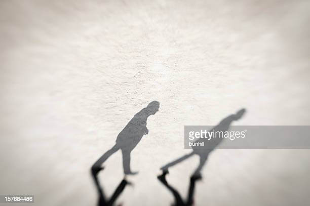 shadowed - followed - film noir style stock pictures, royalty-free photos & images