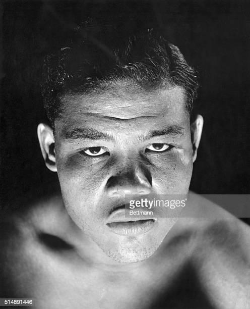 Shadowed headshot of the world heavyweight boxing champion Joe Louis.
