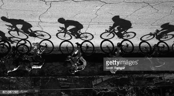 Shadows are cast by cyclists as they compete in the Girls Road Race Cycling Final on day 6 of the 2017 Youth Commonwealth Games on July 23 2017 in...
