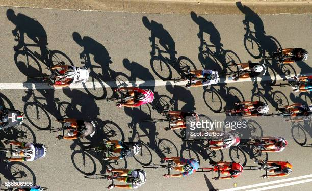 Shadows are cast by cyclists during the Cycling Road Race Test Event along Currumbin Bay on October 29 2017 in the Gold Coast Australia The Road Race...
