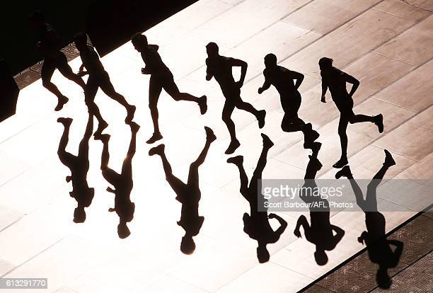 Shadows are cast on the ground as athletes compete in the Shuttle Run beep test during the NAB AFL Draft Combine at Etihad Stadium on October 08 2016...